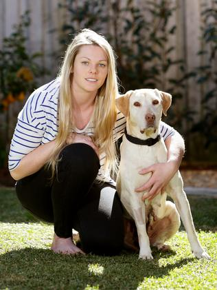 Shae Barnfield adopted Tillie after her rescue, giving the Labrador a new life. Picture: Troy Snook