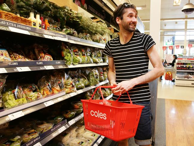 This customer at Coles in Brisbane looks tempted away from the produce. Picture: Claudia Baxter/AAP