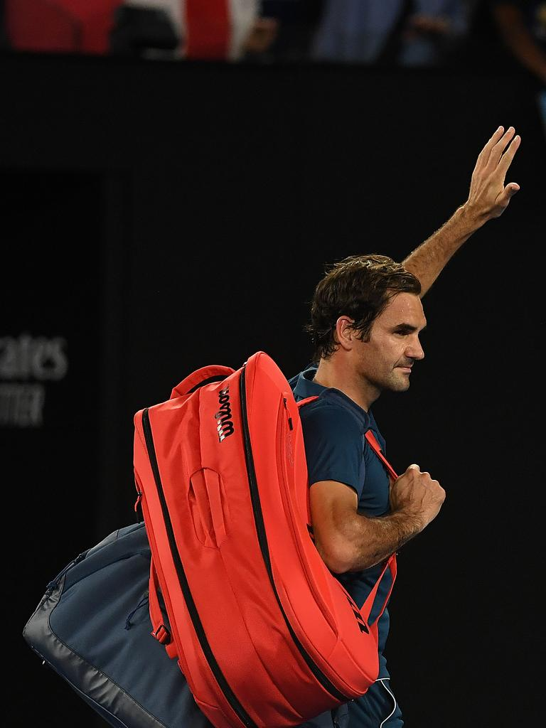 Roger Federer of Switzerland waves to the crowd after being defeated by Stefanos Tsitsipas.