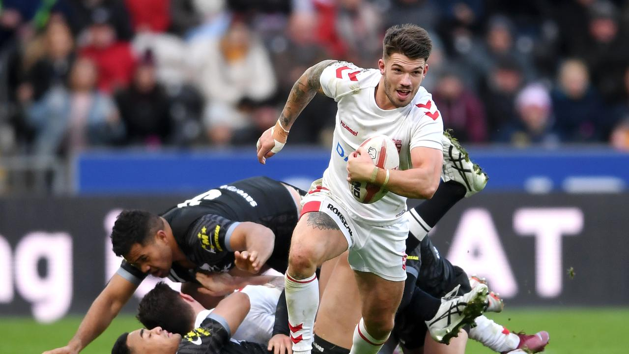 Oliver Gildart of England breaks out before scoring a try.