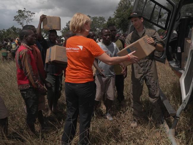 World Vision Australia CEO Claire Rogers helps deliver aid to a remote community outside Beira. Picture: World Vision