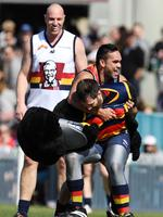 Jarryn Jacky lays a big tackle on the Crows mascot. Pic: Tom Huntley