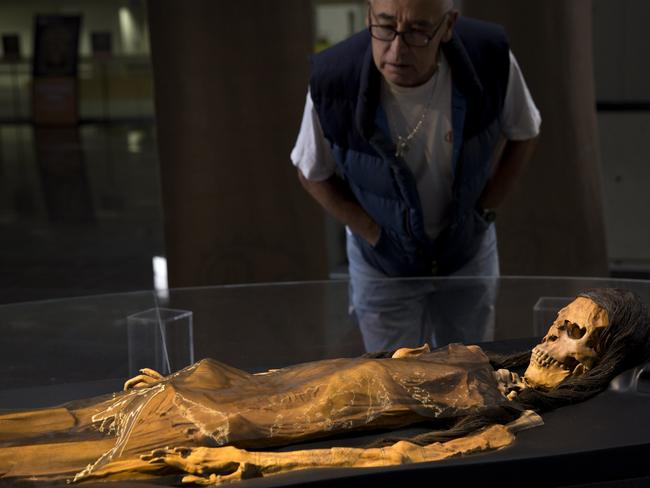 A man looks at a replica of the Lady of Cao's mummy. Picture: Rodrigo Abd