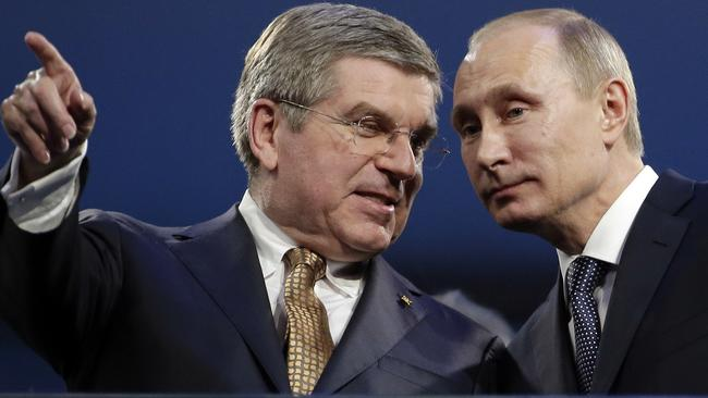 International Olympic Committee President Thomas Bach, left, pictured with the Russian President during the closing ceremony of the 2014 Winter Olympics in Sochi. Picture: Charlie Riedel / AP