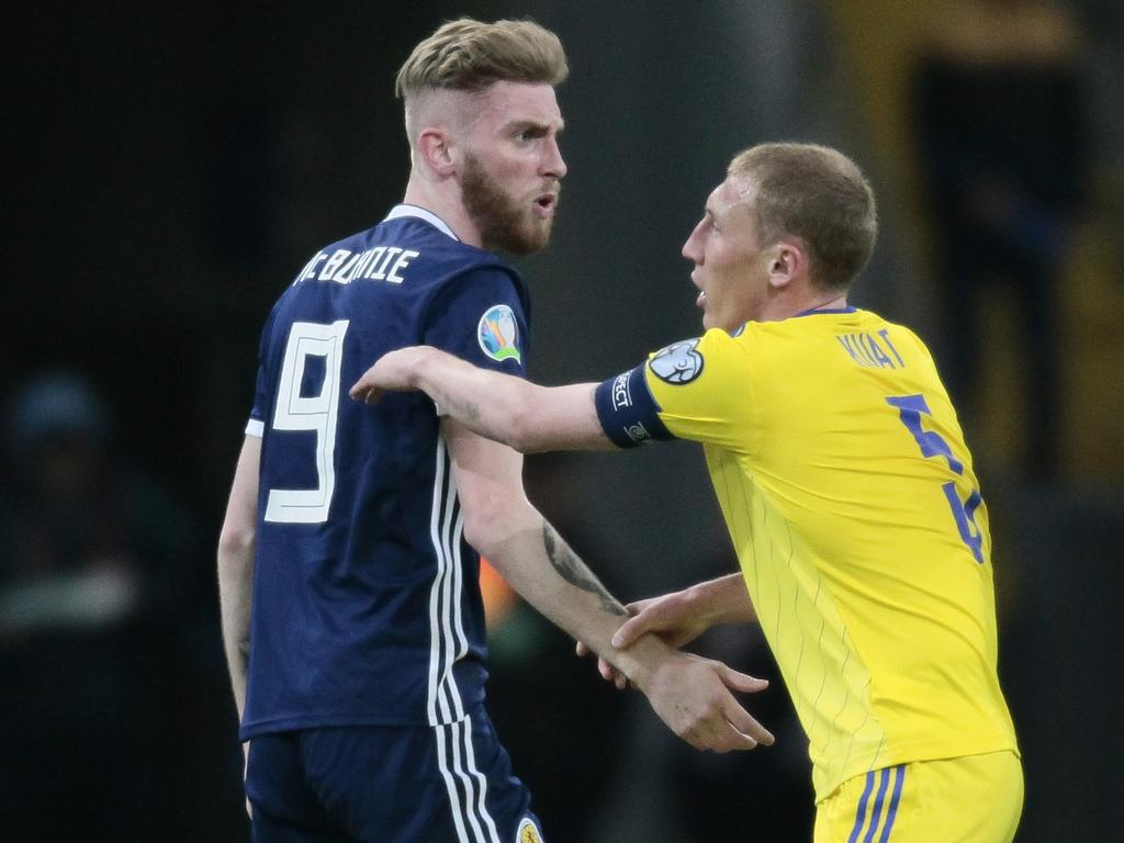 Scotland's Oliver McBurnie, left, argues with Kazakhstan's Islambek Kuat during the Euro 2020 group I qualifying soccer match between Kazakhstan and the Scotland at Astana Arena stadium in Astana, Kazakhstan, Thursday, March 21, 2019. (AP Photo/Alexei Filippov)