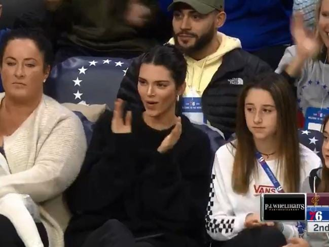 Kendall cheers on Ben during a 76ers game.