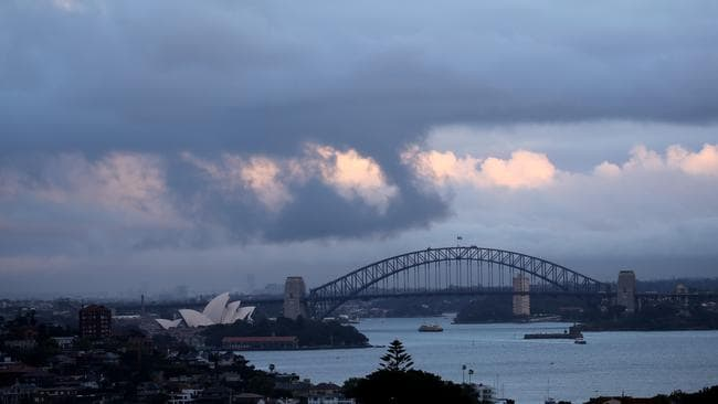 Heavy showers move across Sydney at dawn. Picture John Grainger