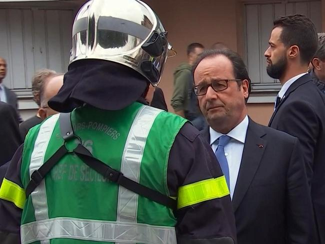 French President Francois Hollande speaks with emergency services personnel after arriving at the scene of the attack. Picture: France Pool via AP