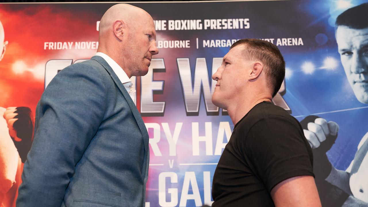 Former AFL player Barry Hall (left) and NRL Cronulla-Sutherland Sharks player Paul Gallen face off during a Code War boxing launch in Melbourne.
