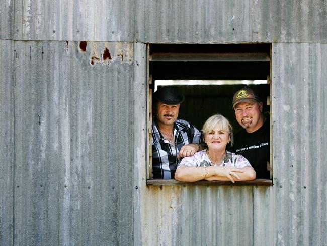 Shannon Noll's brothers Adam and Damian with their mother Sharon on the family farm. The death of her husband and the drought hardship 'ruined' Sharon.
