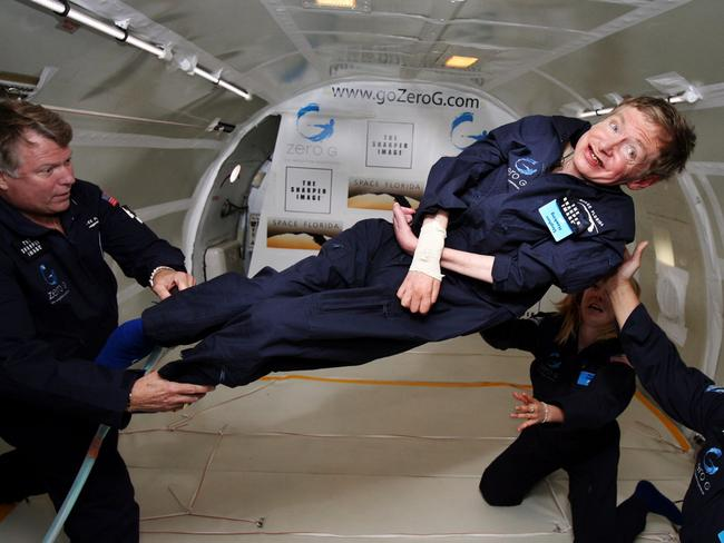 "Stephen Hawking experiences zero gravity during a flight over the Atlantic Ocean. ""It was amazing ... I could have gone on and on,"" Hawking said in 2007. Picture: AFP/ZERO G"