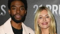 "LOS ANGELES, CALIFORNIA - NOVEMBER 09:  Chadwick Boseman and Sienna Miller attend the photocall for STX Entertainment's ""21 Bridges"" at Four Seasons Hotel Los Angeles at Beverly Hills on November 09, 2019 in Los Angeles, California. (Photo by Jon Kopaloff/Getty Images)"