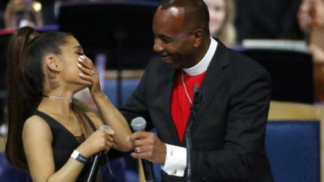 Ariana Grande, left, laughs with Bishop Charles H. Ellis during the funeral service for Aretha Franklin. Picture: AP Photo/Paul SancyaSource:AP
