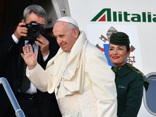 Pope Francis waves as he boards the plane on his way to the his two-day pastoral trip to Ireland. Picture: AFP