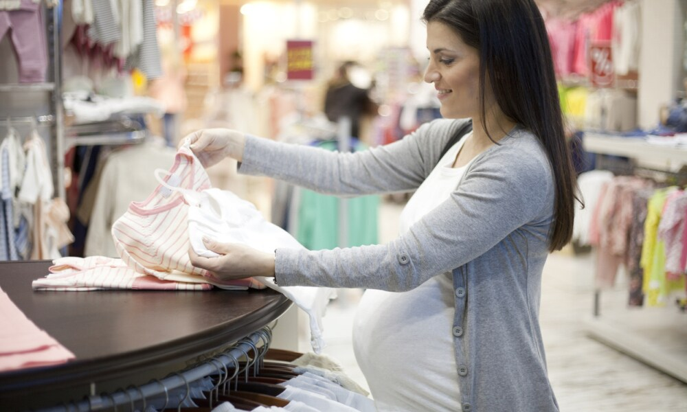 Pregnant woman shopping in baby store.