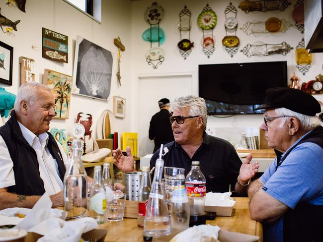 Members of the Cappuccino Club, Hagen Stehr, Mario Valcic and Joe Puglisi share a meal at The Fresh Fish Place cafe in Port Lincoln. Picture: Robert Lang