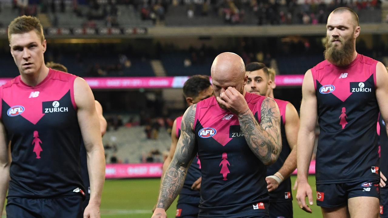 Melbourne players leave the field after losing to Sydney. Photo: Julian Smith/AAP.