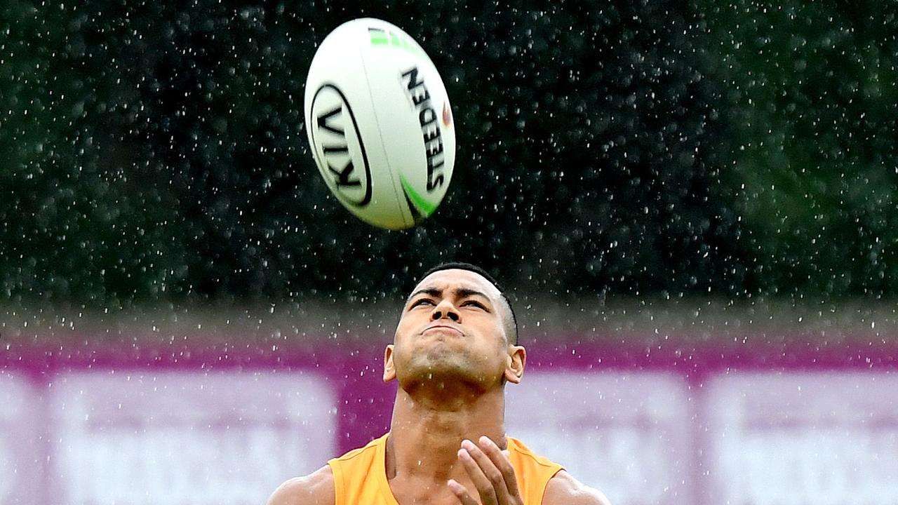 Jamayne Isaako catches the ball during a Broncos training session