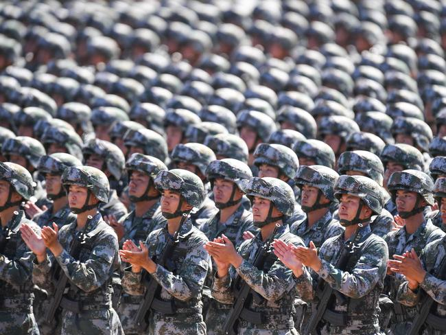 Chinese soldiers applaud during a military parade to mark the 90th anniversary of the People's Liberation Army. Picture: AFP