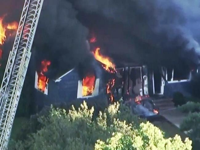 Flames burn through a home in Lawrence. Picture: WCVB