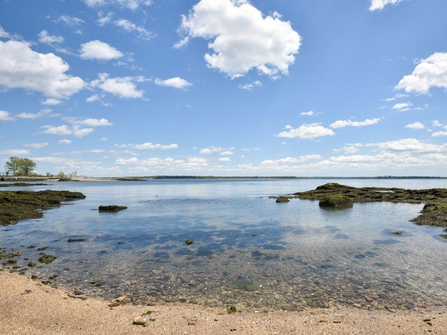 The waters of Long Island Sound are clear on the private beach. Picture: Vizzi Media Solutions/New York Post