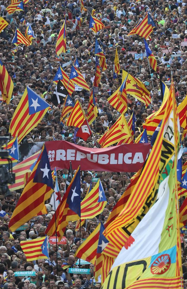 People hold up Catalan independence flags at a Catalan independence rally to demand the release of imprisoned Catalan leaders Jordi Sanchez and Jordi Cuixart. Picture: Getty