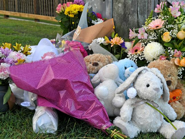 Flowers and cards left at the scene on Raven street. Picture: AAP image, John Gass.