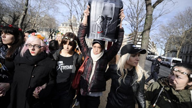 Activists of the Ukrainian women movement Femen demonstrate near the Egyptian embassy in Paris in support of Aliaa Magda Elmahdy (pictured in the upheld black and white portrait).