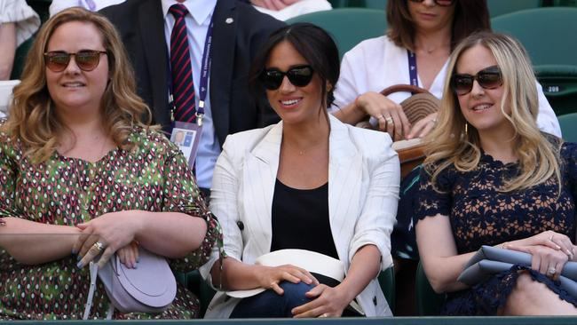 Meghan Markle accompanied by her friends at Wimbledon. Can you spot the Archie tribute? Picture: Laurence Griffiths/Getty Images