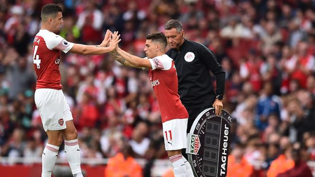 Arsenal's Uruguayan midfielder Lucas Torreira comes on for Arsenal's Swiss midfielder Granit Xhaka.