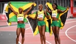 -TOKYO,JAPAN July 31, 2021: Jamaicas from left Shelly-Ann Fraser-Pryce, Elaine Thompson-Herah and Shericka Jackson celebrate the sweep in the 100m final at the 2020 Tokyo Olympics. (Wally Skalij /Los Angeles Times via Getty Images)