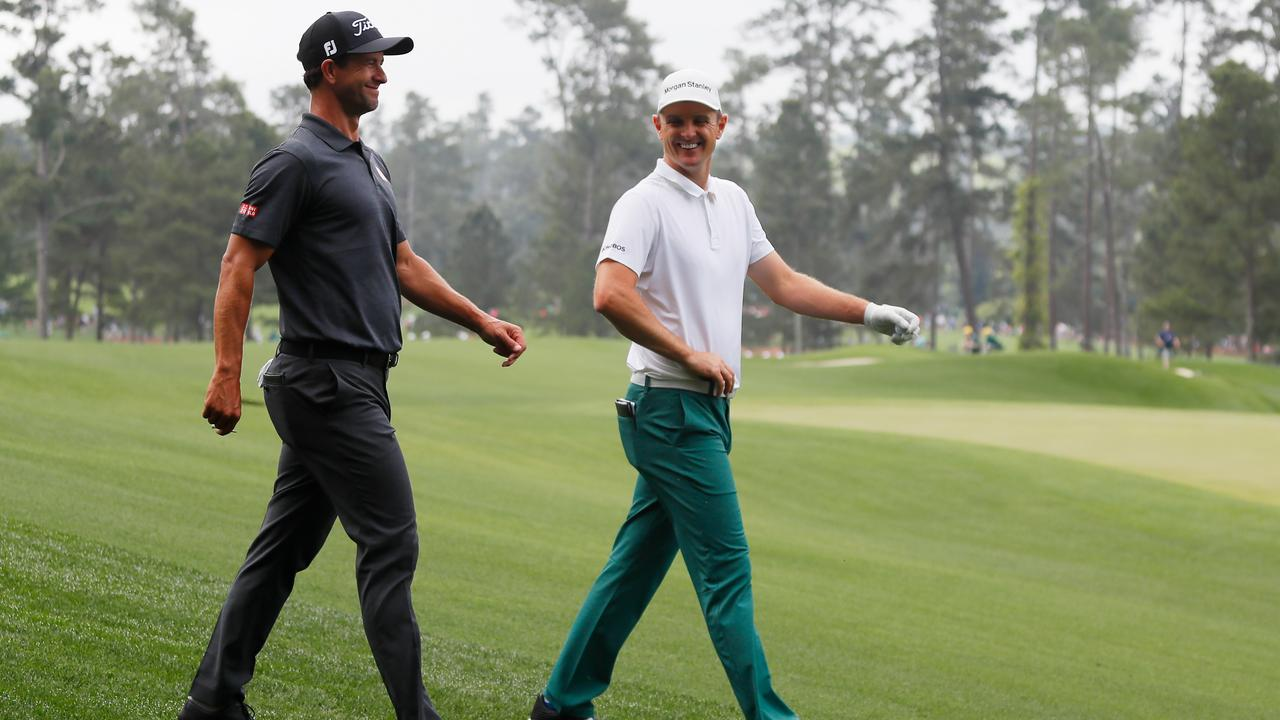 Adam Scott and Justin Rose during a practice round at Augusta National Golf Club this week.