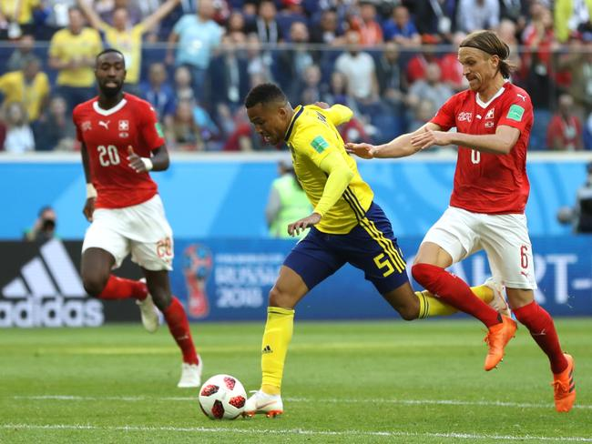 Martin Olsson of Sweden is fouled by Michael Lang. (Photo by Francois Nel/Getty Images)