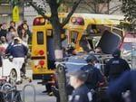 Authorities respond near a damaged school bus Tuesday, Oct. 31, 2017, in New York. Picture: AP Photo/Bebeto Matthews