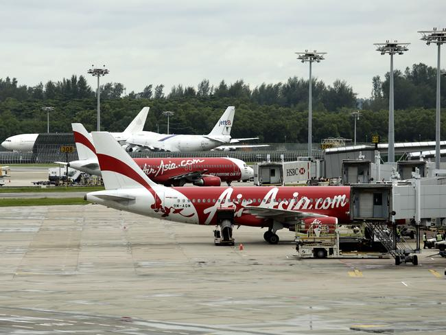 AirAsia planes on the runway.