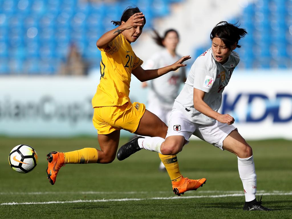 Saki Kumagai of Japan and Samantha May Kerr of Australia in action.