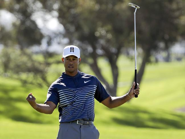 Tiger Woods reacts after sinking a birdie putt on the first hole during the second round of the Farmers Insurance Open.