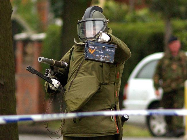 A Royal Logistic Corps bomb disposal expert approaches a house in Birmingham, England, where detectives investigating the failed July 21 London bomb attacks made an arrest under the Terrorism Act.