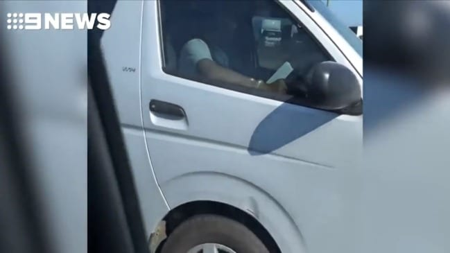 Driver caught reading behind wheel (Nine)