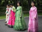 North Korean women in traditional dress walk to pay their respects to the Mansudae Grand Monument, huge statues of Kim Il-sung and Kim Jong-il, on August 19, 2018 in Pyongyang, North Korea. Picture: Carl Court/Getty Images