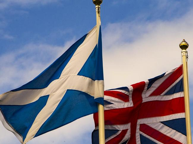 The Scottish Saltire and the Union Flag flutter in Scotland, which is waiting for a visit from Harry and Meghan. Picture: AFP