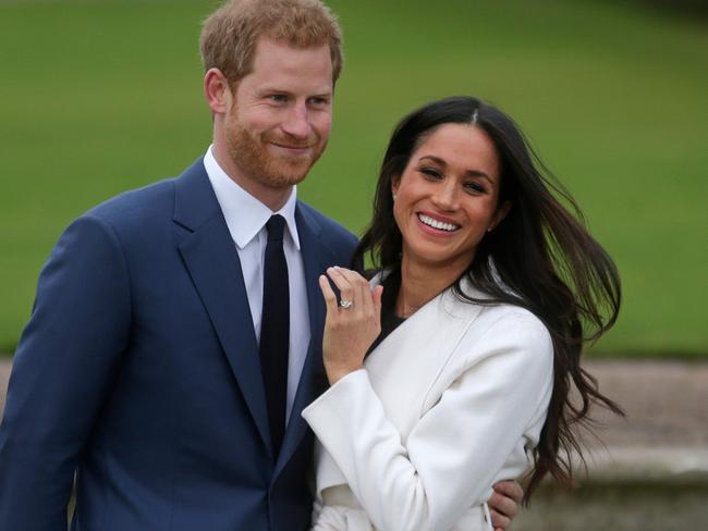 Meghan Markle, with prince Harry, shows off her sparkler. Picture: AFP/Daniel Leal-Olivas