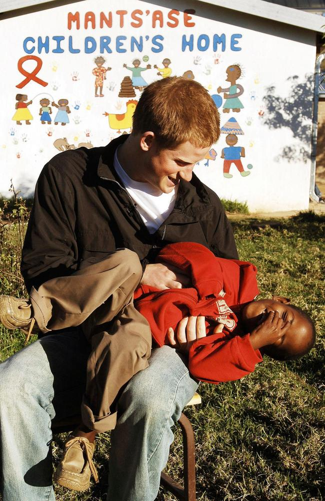 Harry plays with Mutsu in the grounds of the Mants'ase Children's Home while on a return visit to Lesotho in Southern Africa in April 2006. Picture: AFP