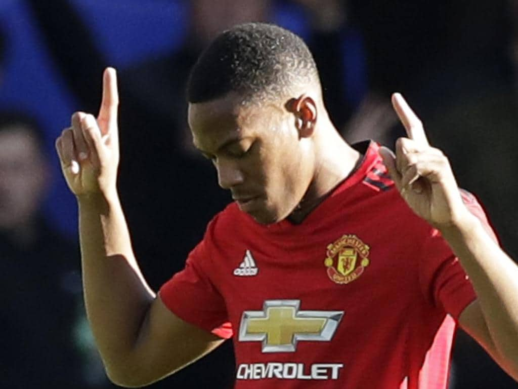 ManU forward Anthony Martial celebrates scoring his side's first goal during their English Premier League soccer match between Chelsea and Manchester United at Stamford Bridge stadium in London Saturday, Oct. 20, 2018. (AP Photo/Matt Dunham)