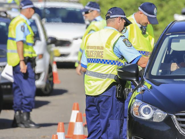 Police conducting random breath tests on New Year's Day in Revesby. Picture: Dylan Robinson
