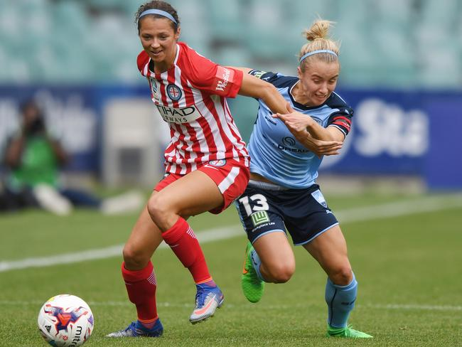 City's Ashley Hatch and Sydney's Georgia Yeoman-Dale tussle for the ball earlier in the season. Picture: AAP
