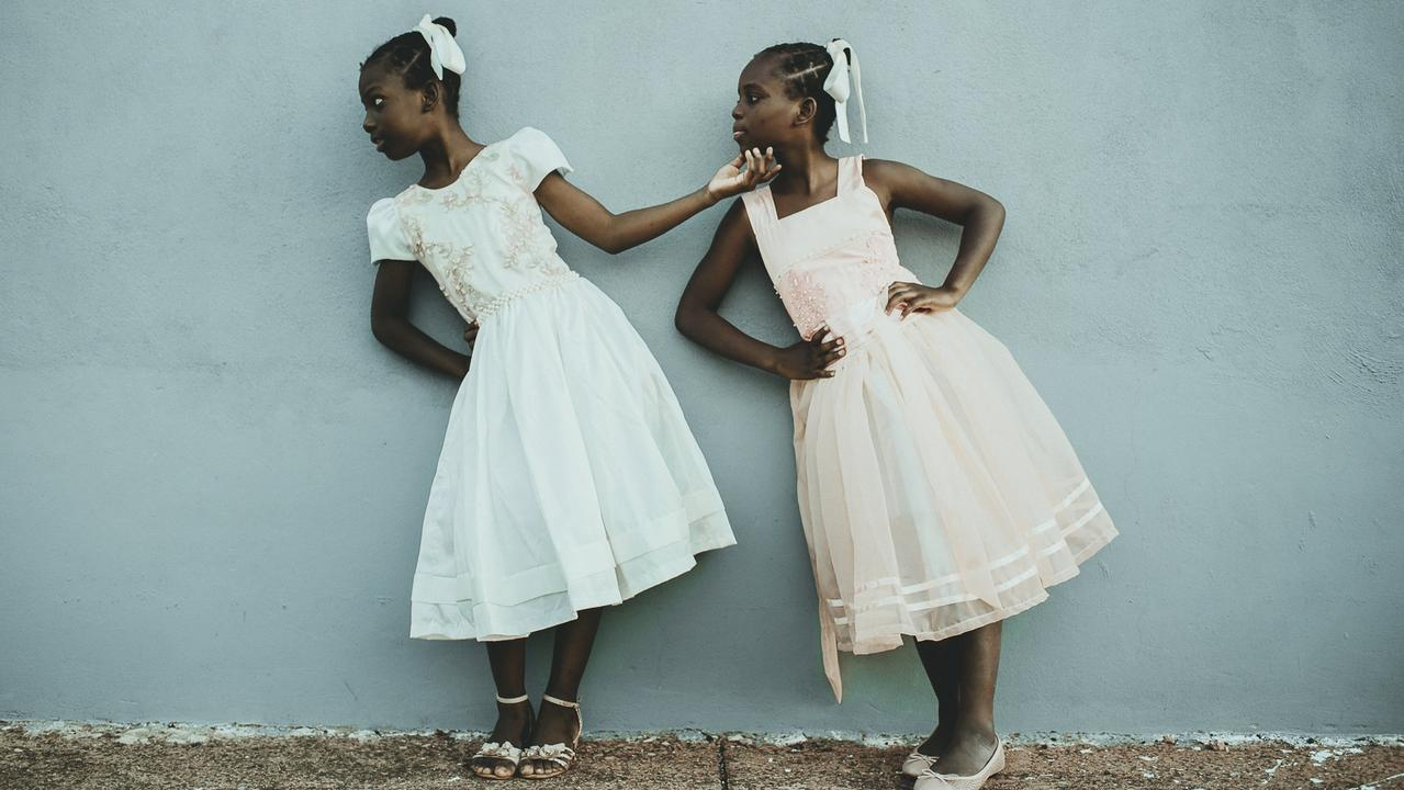 """Leida and Laelle — I will lift you up"" is the title of the second place winner in the People category, of twin sisters who live in Brazil and are refugees from Haiti. Picture: Tati Itat"