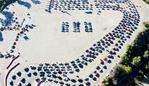 LOS ANGELES, CALIFORNIA - NOVEMBER 30: In an aerial view from a drone, cars are lined up at Dodger Stadium for COVID-19 testing on the Monday after Thanksgiving weekend on November 30, 2020 in Los Angeles, California. Health officials in Los Angeles County have issued a new limited stay-at-home order in effect for the next three weeks amid a surge in coronavirus cases. Mario Tama/Getty Images/AFP == FOR NEWSPAPERS, INTERNET, TELCOS & TELEVISION USE ONLY ==