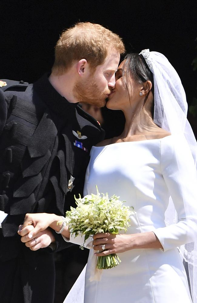 Prince Harry and Meghan Markle kissed outside St George's Chapel. Picture: Ben Stansall/pool photo via AP