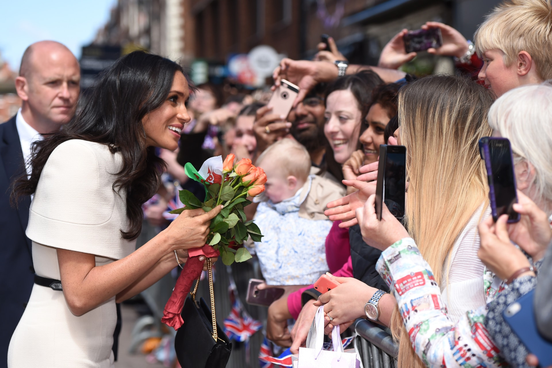 Meghan Markle speaks to well wishers. Image credit: Getty Images